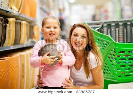 mother and daughter in shopping mall