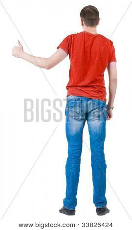 Back view of young men in  red t-shirt going thumb up. Rear view. Isolated over white background. Guy  looks away and showing of positive emotions with OK sign concept .