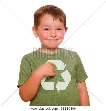 Recycling for the future concept with smiling child proudly pointing at recycling logo on his green