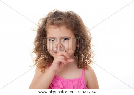 child with secret finger to lips for quiet