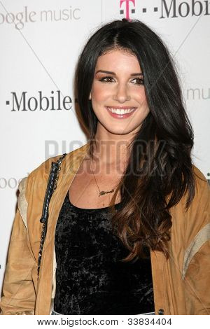 LOS ANGELES - NOV 16:  Shenae Grimes arrives at the Google Music Launch at Mr. Brainwash Studio on November 16, 2011 in Los Angeles, CA