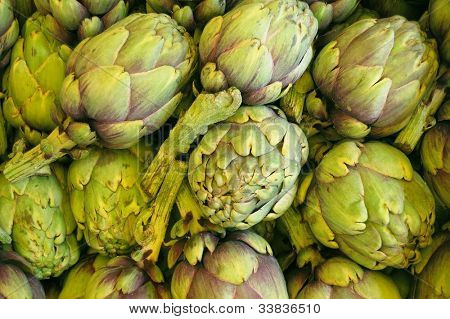 baby - artichokes are in a market for fruit and vegetables ready for sale.