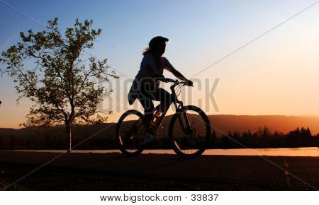 Woman Riding Her Bike