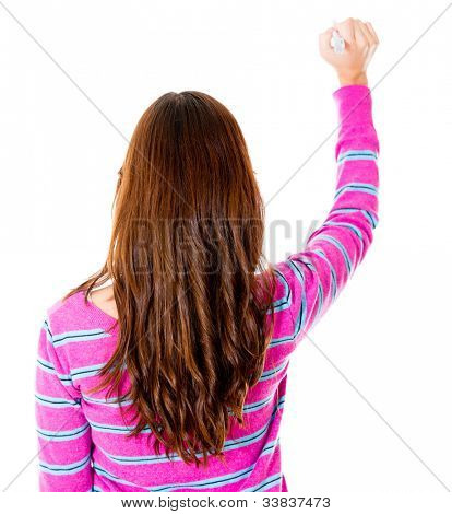 Rear view of a woman writing on the wall - isolated over white background