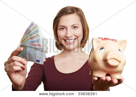 Happy woman holding Euro money bill fan and piggy bank