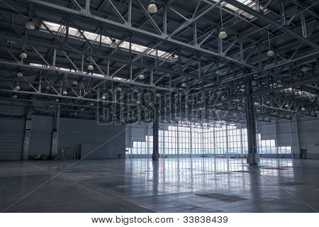 Large modern storehouse with window at wall