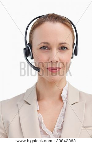 Portrait of a businesswoman wearing a headset against white background