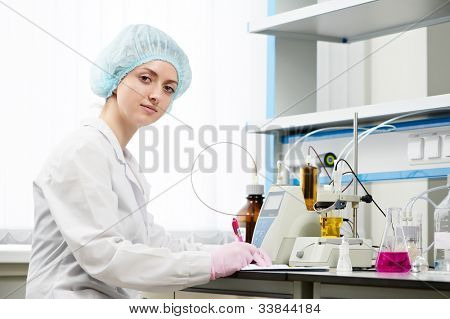 Female pharmacy doctor or medical scientific researcher making medicine experiment in a laboratory