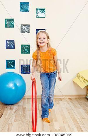 Elementary aged girl in a school gym