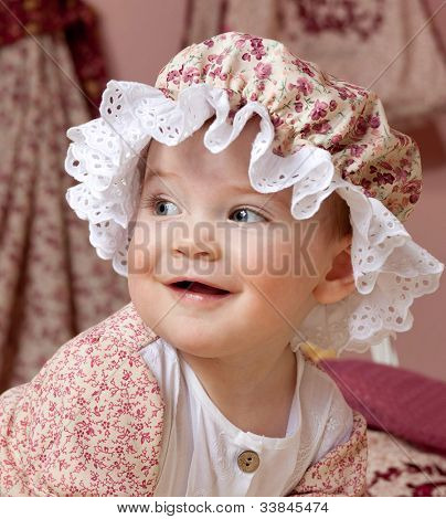 little child baby girl portrait face closeup hat smiling happy
