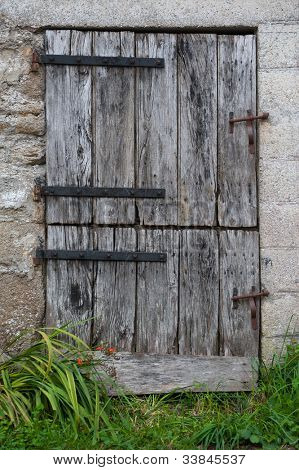 Old farm door with double opening
