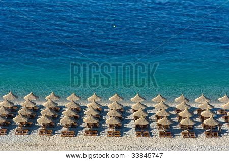sunshade umbrellas and deckchairs on the beach in Bay Jal, Albania