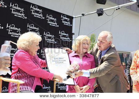 LOS ANGELES, CA - JUN 4: Betty White, Tom LaBonge at the unveiling of Betty White's wax figure at Madame Tussauds Hollywood on June 4, 2012 in Los Angeles, California