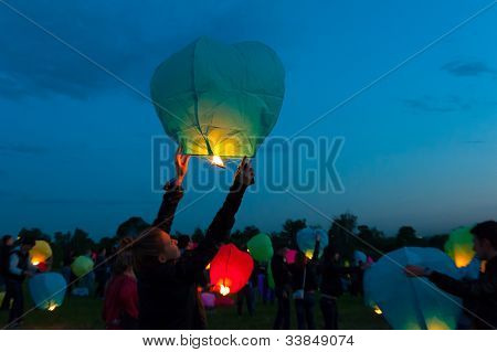 MOSCOW - JUNE 1: Girl releases a floating lantern during the First Day of Summer Festival, on June 1, 2012 in Moscow. During the festival flew more than 1,000 lights.