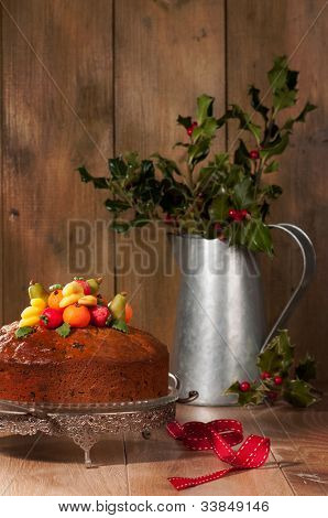 Christmas fruit cake decorated with marzipan fruits