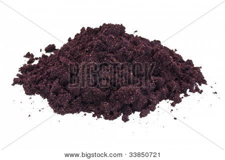 a pile of organic freeze-dried maqui fruit (Aristotelia Chilensis) powder isolated on white