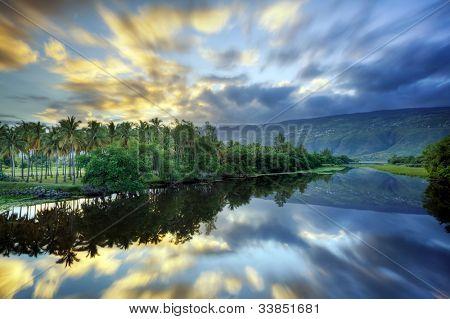 Scenic Etang Saint Paul river at dawn, Reunion Island.