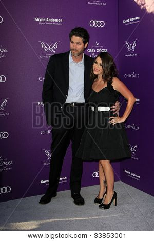 LOS ANGELES - JUN 9:  Jason Goldberg, Soliel Moon Frye arriving at 11th Annual Chrysalis Butterfly Ball at Private Residence on June 9, 2012 in Los Angeles, CA