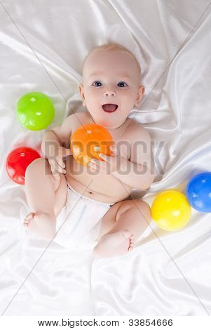 Happy baby with colored balls