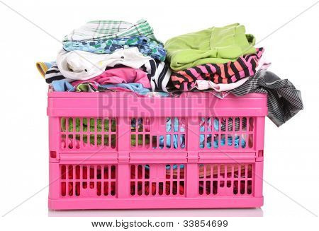 Clothes in pink plastic basket isolated on white