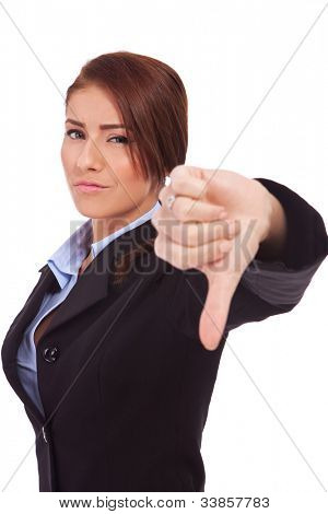 Young business woman gesturing thumbs down over white