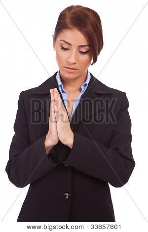 business woman praying on a white background