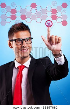 young business man wearing glasses, pressing a digital buttonon a virtual touch screen