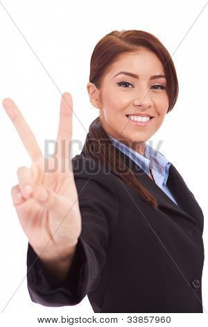 Portrait of happy beautiful business woman showing victory sign, isolated