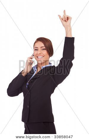 Portrait of a beautiful business woman making a phone call and very happy with the good news