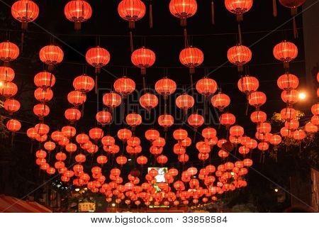 illuminated chinese lanterns hanging in bangkok street for new year celebrating