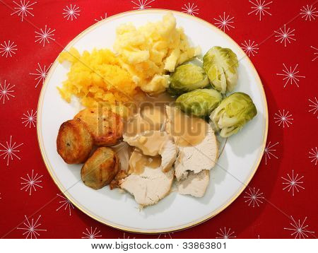 A typical English Christmas dinner of turkey, boiled swede, Brussels sprouts, roasted and mashed potato.