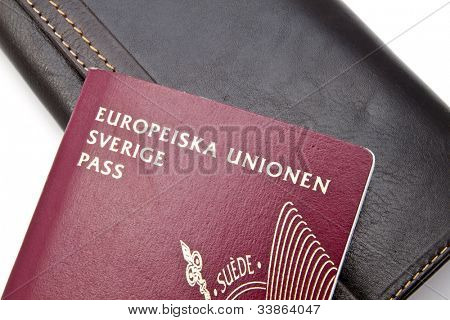 Swedish passport and wallet closeup on white background