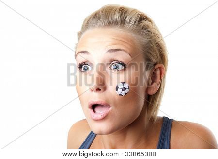 Worried football fan, cute girl with face paint, expressing surprised emotions, shocked and disappointed female watching ball competition, sport team supporter, young woman having fun