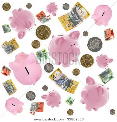 Piggy banks and Australian money falling over white background.