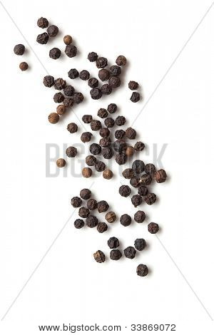 Black peppercorns isolated on white background.  Overhead view.