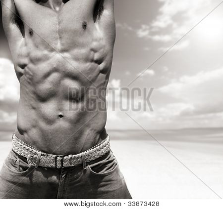 Naked torso with high detail showing defined muscular body against dramatic background