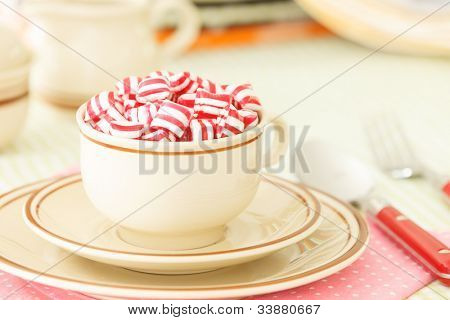 Candies in a teacup on the table