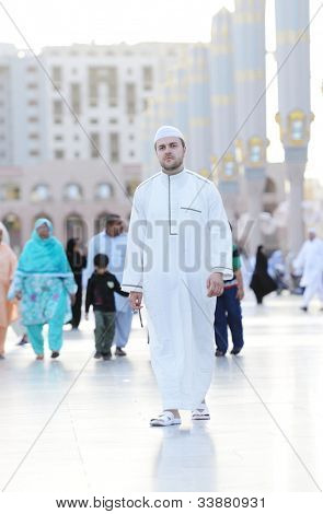 Muslim walking at holy Islamic places