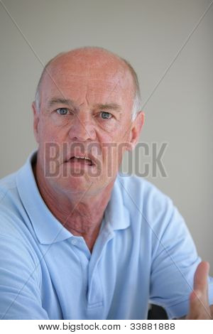 Funny bald man with confused look on his face