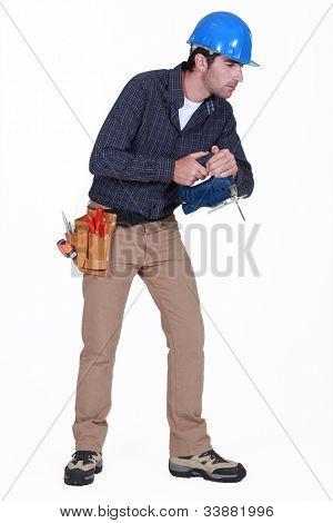 Tradesman staring at the floor