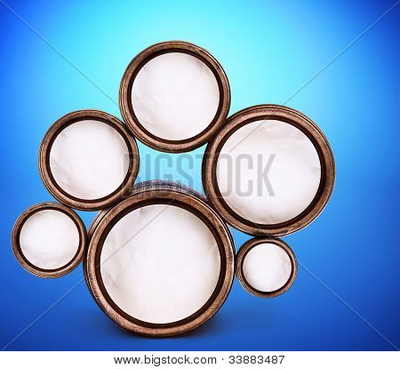 Abstract design of round shapes in the form of beer barrels on a blue background. Inside the barrels textured watercolor paper.