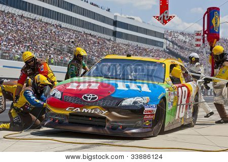DOVER, DE - JUN 03:  Kyle Busch (18) brings in his MMs Toyota for service during the FedEx 400 Benefiting Autism Speaks at the Dover International Speedway in Dover, DE.