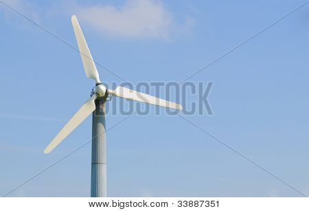 solitary wind turbine on a power generating farm in California, with room for your text