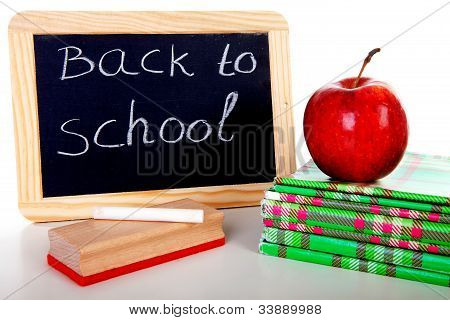 Back To School: Blackboard Slate And Stack Of Books
