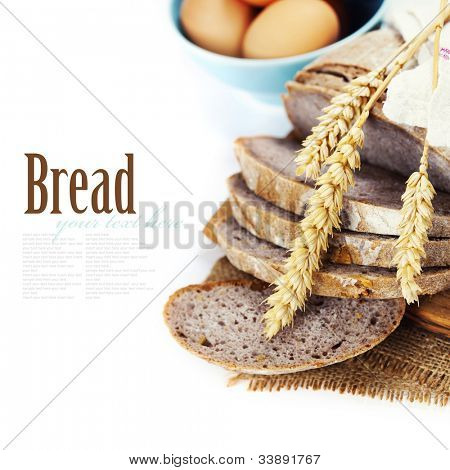 Freshly baked  bread with homespun fabric and eggs on white background  (with easy removable text)