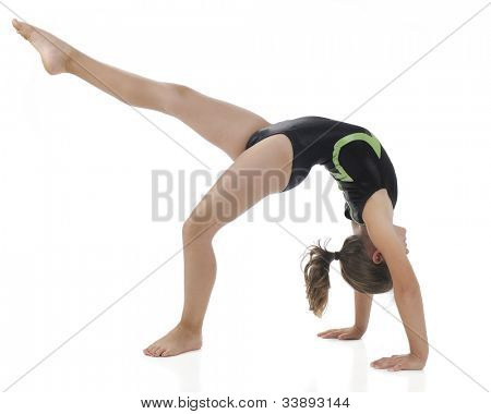"A side view of an elementary gymnast making a ""bridge"" and kicks out with one leg. On a white background."