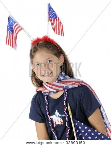 Portrait of a pretty elementary girl dressed to celebrate American's Fourth of July.  On a white background.