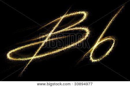 "Letter ""B"" of gold glittering stars dust trail (glittering font concept)"