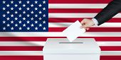 Election In United States. The Hand Of Man Putting His Vote In The Ballot Box. Waved United States F poster