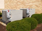 foto of air conditioner  - two heavy duty air conditioner units by a brick building - JPG